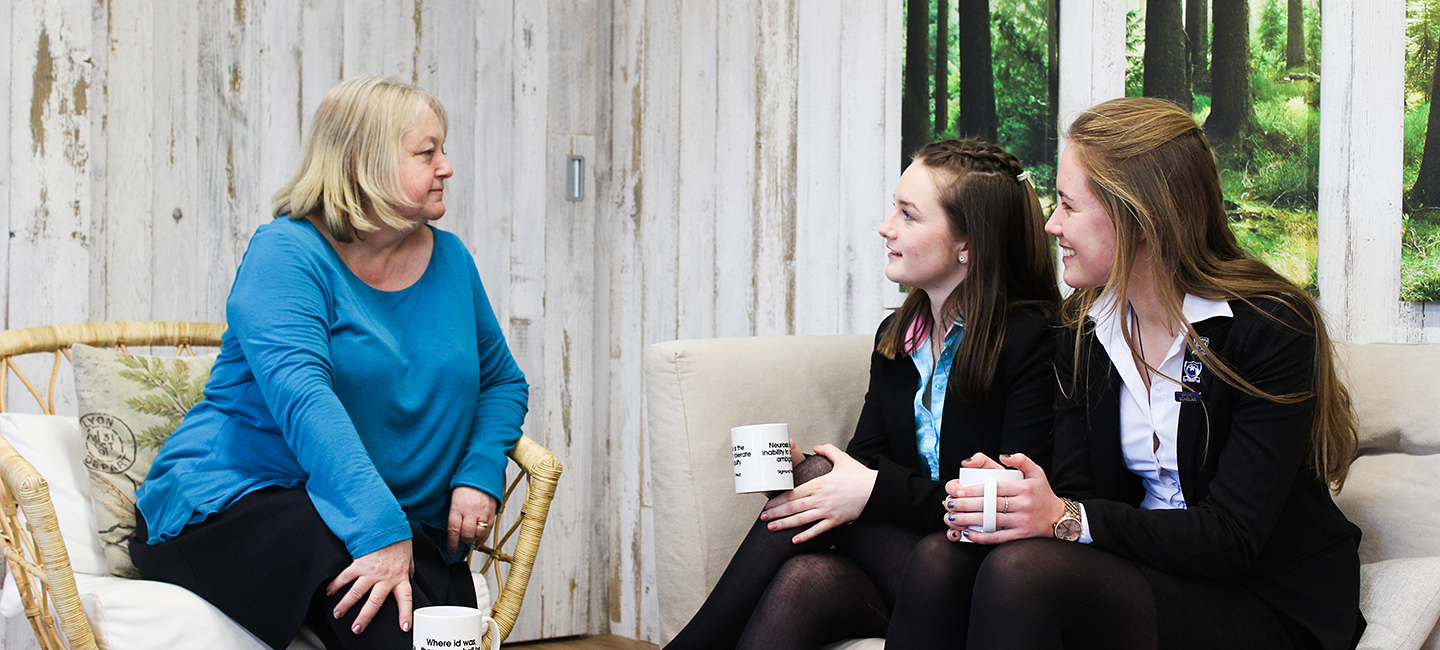 A counsellor talks openly with two Felsted students