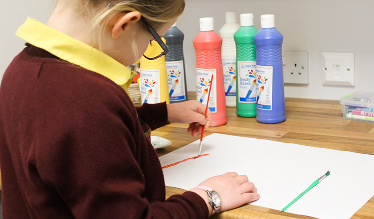 A Felsted Prep School student paints during art class