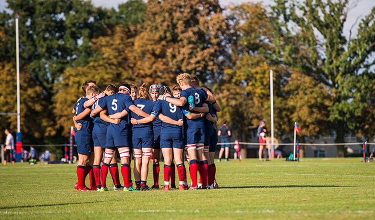 Felsted's rugby team huddle before a game